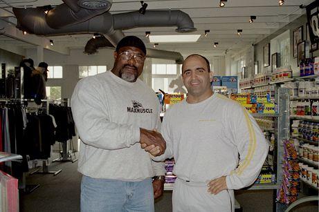 Joe Antouri with Graig Monson, one of the biggest bodybuilders ever.