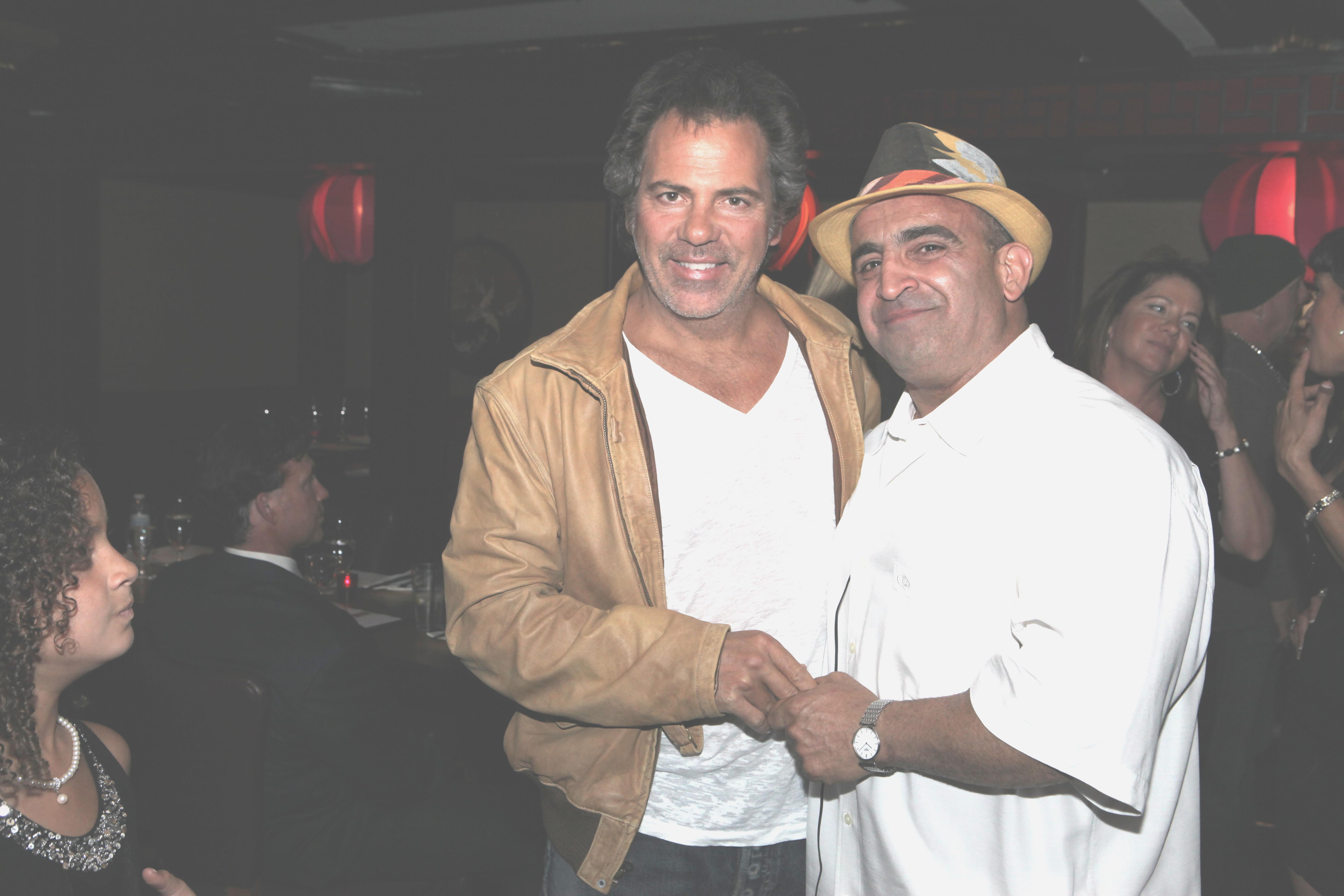 Joe Antouri with Mentor Tom Gores.
