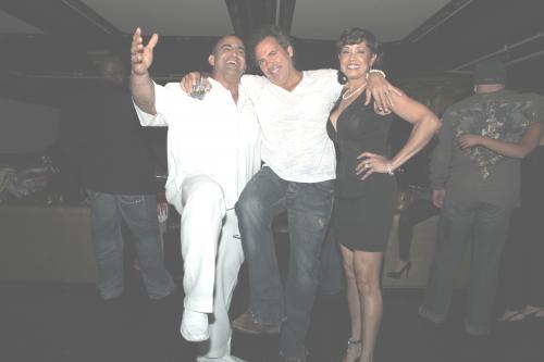 Joe antouri, Tom Gores and Edna Antouri at joe's 50th birthday party.